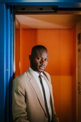 Elegant african businessman in the elevator