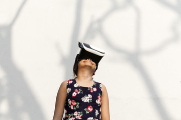 Teenage girl wearing virtual reality headset