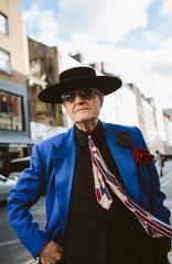 Cool Progressive senior in Blue jacket in the city.