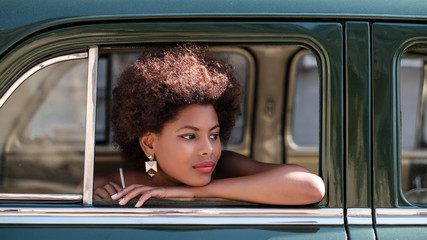 Beautiful African Woman Sitting Inside The Car