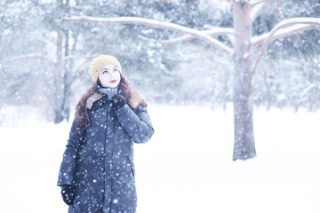 Beautiful girl in a beautiful winter snow