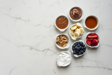 various dessert condiments in small bowls