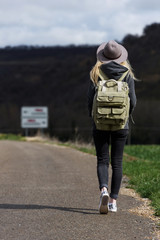 Woman with backpack on roadside