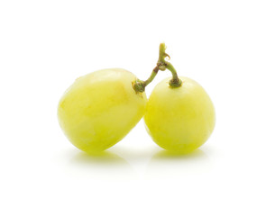 Two grape berries (Early Sweet or Grapaes variety) isolated on white background green ripe.