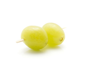 Two grape berries (Early Sweet or Grapaes variety) with wood stick isolated on white background green ripe canape.
