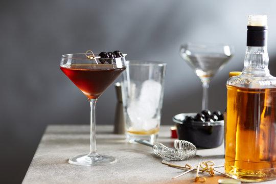 Manhattan cocktail with maraschino cherries on top.