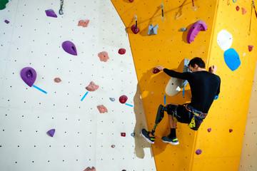 Amputee conquering climbing wall