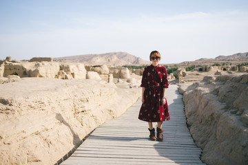 young lady  in site of an ancient city