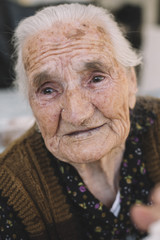 Old woman with tiers in eyes