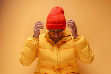 Young man with puffer jacket and knit cap