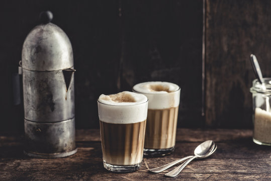 Coffee: Latte macchiato, espresso and foamed milk in glasses