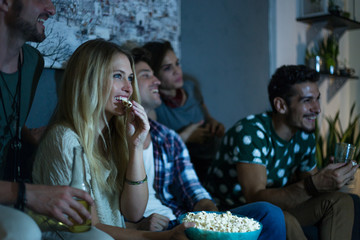 Group of friends watching movie together