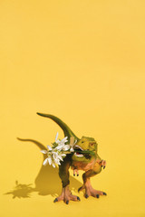 Small plastic T-Rex with flowers in mouth
