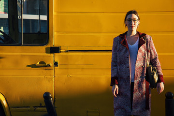 Woman standing near yellow van