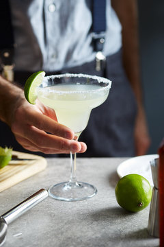 Delicious Margarita cocktail with slice of lime.