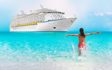 Cruise ship luxury travel Caribbean vacation woman happy on summer holidays swimming in blue ocean water. Happiness bikini girl running with open arms in success enjoying tropical sun.