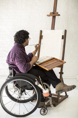 Man in wheel chair painting
