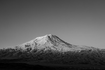 snowcovered mount ararat in evening light, turkey - black and white
