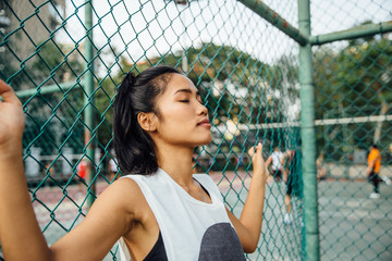 Young Woman Outside a Basketball Court