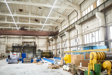 Wide angle view of empty industrial workshop at industrial plant, background with copy space