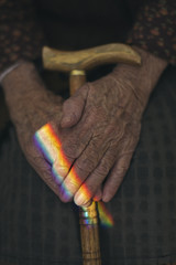 A rainbow on mature hands.