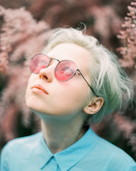 Portrait of female wearing pink sunglasses