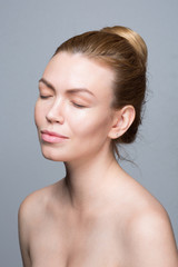 Beauty shoot, expressive ginger woman with great skin over white background