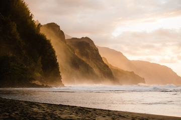 crashing waves and cliffs at sunset in Hawaii