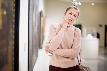 Woman with guide looking at pictures in museum