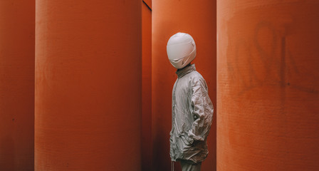 Abstract scene with person with white helmet/mask and silver jacket i.