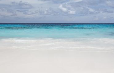 White beach sand and beautiful blue sea and sky