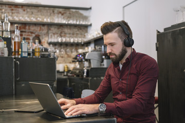 Cheerful man at the laptop