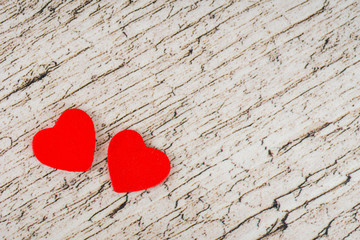 valentine's day card, two red hearts on white wooden rustic planks