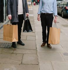 Two male friends shopping in London.