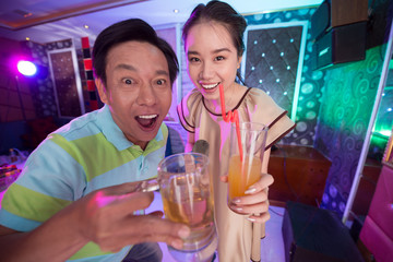 Father and daughter in karaoke