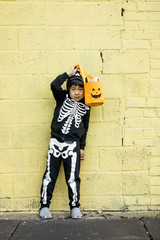 Asian Boy in Halloween Skeleton Costume