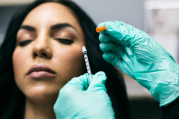 Woman Receives Cosmetic Injection from Nurse