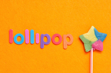 The word lollipop with a colorful star shape lollipop