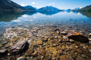 Low angle view at Lake Wakatipu with snow capped mountains and Pig and Pigeon Islands in the background, famous location in New Zealand's Southern Island.