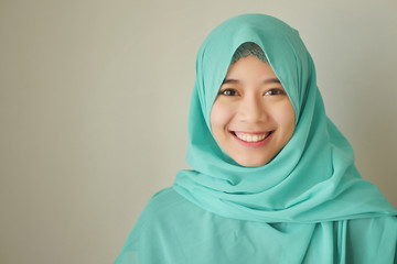 portrait of happy smiling asian muslim woman