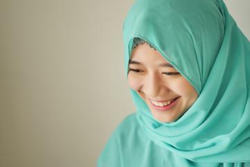 portrait of happy smiling asian muslim woman