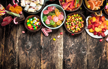 Different sweet candy, jelly, marshmallows and candied fruits. Wall mural
