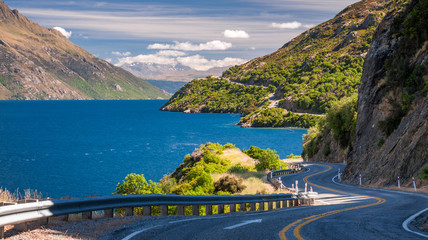 Panorama of Lake Wakatipu with the winding road along the lake shore, not far from Queenstown, in the Southern Island of New Zealand.