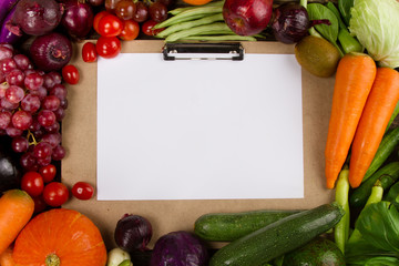 Top view of Fruits and Vegetable border with writing pad and paper for writing text, Salad Menu, Fresh produce, restaurant and vegetarian concept.