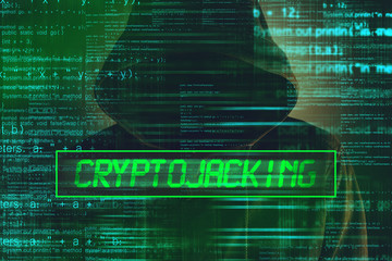Cryptojacking concept, computer hacker with hoodie