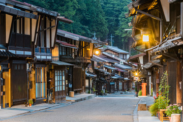 Narai-juku, Japan - September 4, 2017: Picturesque view of old Japanese town with traditional wooden architecture. Narai-juku post town in Kiso Valley, Japan Wall mural