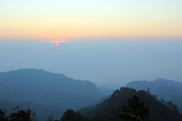 top hills and sunrise at Doi Ang Khang. Composition of the nature at Chiangmai Thailand