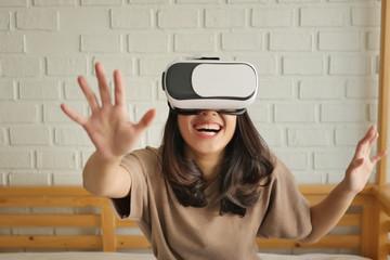 happy woman enjoying, playing VR Virtual Reality headsets
