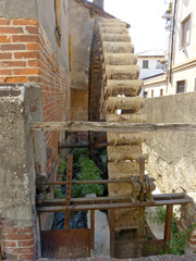 An old mill abandoned in the narrow alleys of the village of Soncino - Italy
