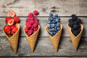 Selection of summer berries in ice cream cones